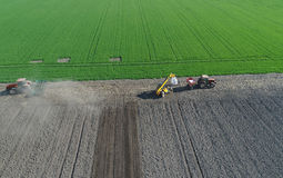 Agricultural work on field in spring. Harrowing and fertilizing, preparation of soil for sowing Royalty Free Stock Photo