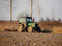 Agriculture. A farmer with tractor working on a field Royalty Free Stock Photo