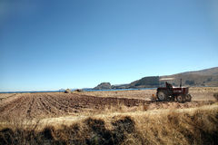 Agriculture. Tractor on the shores of Lake Titicaca, Bolivia Royalty Free Stock Image