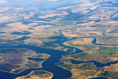 Agriculture Aerial View. Aerial view of agriculture land with lakes and streams for irrigation Royalty Free Stock Photography