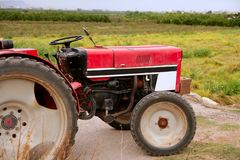 Agriculture aged red tractor  retro vintage Stock Photo