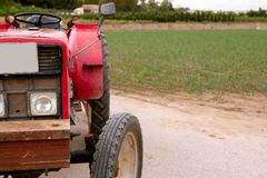Agriculture aged red tractor  retro vintage Royalty Free Stock Photography