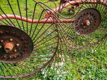 Agriculture. Agricultural mechanical tools for haymaking. Swather. Four-star rotary rake. Detail. This mechanical device, dragged by a tractor, is used to royalty free stock images
