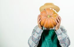 Agriculture concept. Farmer guy carry big pumpkin. Locally grown foods. Local farm. Farmer lifestyle professional royalty free stock photography