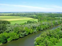 Agriculture, fields in wooded area, Morava river, top view. Agriculture and cultivated lands. Rural landscape. Yellow and green fields in wooded area along Stock Photos