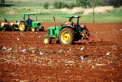 Agriculture Cultivation. Image of farm workers ploughing and preparing a field for planting crops Stock Photography