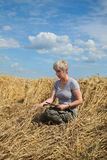 Agriculture, desperate farmer in damaged wheat field Stock Image