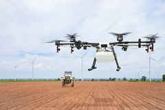 Agriculture drone flying on preparing land Stock Photos
