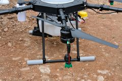 Agriculture drone for spraying liquid fertilizer or herbicide in. Farm land Stock Photography