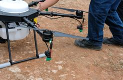 Agriculture drone for spraying liquid fertilizer or herbicide in. Farm land Royalty Free Stock Image