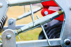 Pneumatic, hydraulic machinery made of steel closeup. Agriculture equipment concept. Industrial detailed pneumatic, hydraulic machinery made of steel closeup stock photography