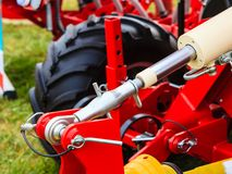 Pneumatic, hydraulic machinery made of steel closeup. Agriculture equipment concept. Industrial detailed pneumatic, hydraulic machinery made of steel closeup stock images