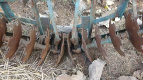 Old unused plow harrow. Agriculture equipment of an old unused rusted plow harrow or tractor part or cultivator Stock Photos