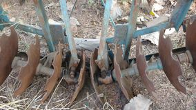 Old unused plow harrow. Agriculture equipment of an old unused rusted plow harrow or tractor part or cultivator Royalty Free Stock Photography