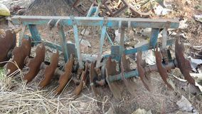 Old unused plow harrow. Agriculture equipment of an old unused rusted plow harrow or tractor part or cultivator Stock Image