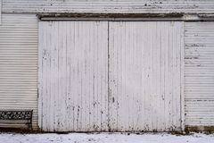 Old Barn ir shed with weathered wood on Farm. Agriculture Farm in the midwest Ameriica with  wood fading windows and icicles in winter with white painted siding Stock Image