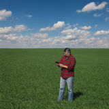 Agriculture, farmer examine wheat plant in field Royalty Free Stock Photography
