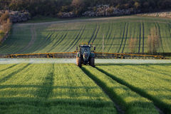 Agriculture - Farmer Spraying Crops stock image