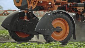 Agricultural machinery for pollination plants moving on field. Spraying machine stock video footage