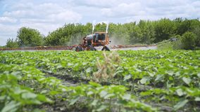 Agriculture fertilizer working on field. Pesticide spraying. Irrigation field stock video