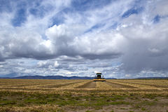 Agriculture Field And Equipment Under Storm Skies Royalty Free Stock Photography