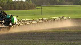 Agriculture field spray with herbicide. Handheld slow motion 100fps follow shot