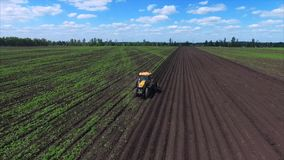 Agriculture field and tractor stock video footage