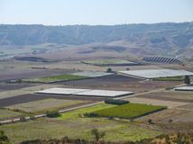 Agriculture in glasshouses and on fields. The landscape between Apulia and Basilicata with agriculture in the south of Italy Stock Photos