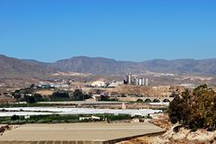 Agriculture and industry, Almeria, Andalusia, Spain. Cement works and agricultural land in the mountains, Costa Almeria, Almeria Province, Andalusia, Spain Stock Photos