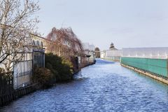 Agriculture industry along a canal in Boskoop Stock Image