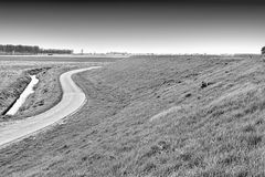 Road, Dam and Canal in Holland Royalty Free Stock Images