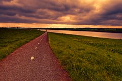 Road, Dam and Canal in Holland Royalty Free Stock Image