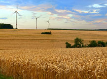 Agriculture landscape. With wind turbines, by Beckingen, Saarland - Germany, warm evening sun, stitched - original size Royalty Free Stock Photos