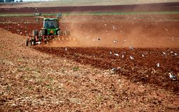 Agriculture Landscape. Agricultural landscape Image of farm workers using a tractor ploughing and preparing a field for planting corn Stock Photography