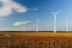 Agriculture landscape with wind turbines Stock Photos