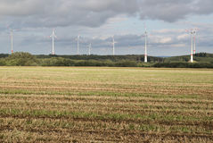 Agriculture landscape with wind turbines Royalty Free Stock Photo