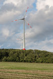 Agriculture landscape with wind turbines Stock Photo