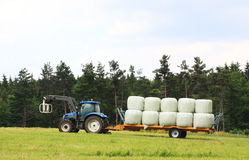Agriculture - Loading Hay Bales Royalty Free Stock Photos