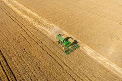 Agriculture machine harvesting crop in field Royalty Free Stock Photo