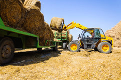 Agriculture machine lift tractor loading farm Royalty Free Stock Images