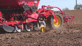 Agriculture machine sowing seeds and cultivating field stock video footage