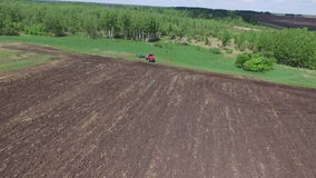 Agriculture machine spread fertilizer on cultivated field soil in summer. Planting crops stock video