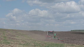 Agriculture machine spread fertilizer on cultivated field soil in summer. Planting crops, stock video