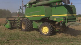 Agriculture machinery harvest ripe dry pease plants. Stork birds. SIRVINTOS, LITHUANIA - August 3, 2014: Agriculture machinery harvest ripe dry pease plants on stock video