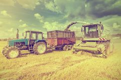 Agriculture machines collect hay. Stock Images