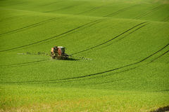 Agriculture on Moravia rolling hills with wheat filds and tractor Royalty Free Stock Images