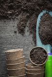 Agriculture peat pots soil shovel on wooden board Royalty Free Stock Photos