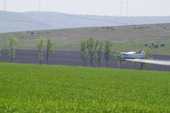 Agriculture plane. Plane drops chemicals in a agiculture fild Stock Images