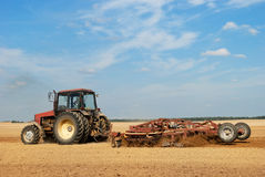 Agriculture ploughing tractor outdoors Stock Photos