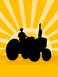 Agriculture progress. The tractor on sunburst background Royalty Free Stock Images